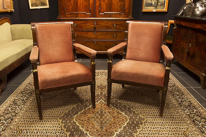pair of (�) antique Empire-style armchairs in mahogany with beautiful and typical montings in gilt bronze