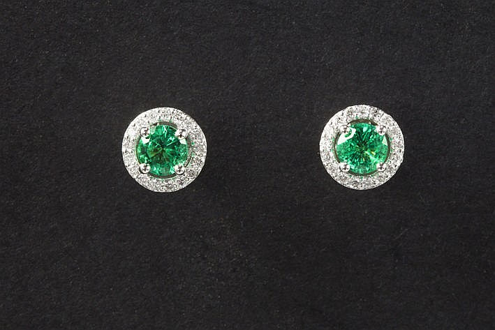 pair of earrings each with a green stone and a total of 030 carat of high quality brilliants