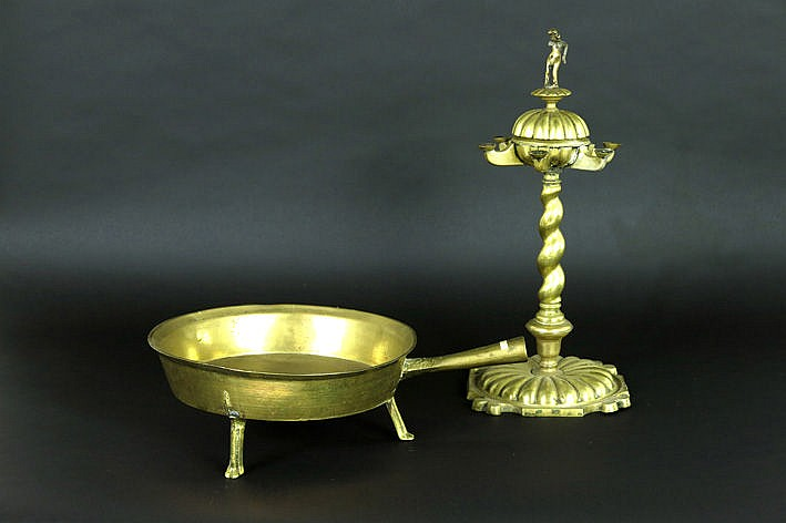 15th/16th Cent. oillamp in brass and a pan on feet probably from the 18th Century