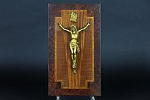 crucifix in bronze on a panel in marquetry
