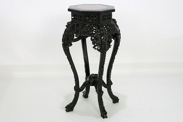 Chinese pedestal in richly carved ironwood with an octogonal top with marble