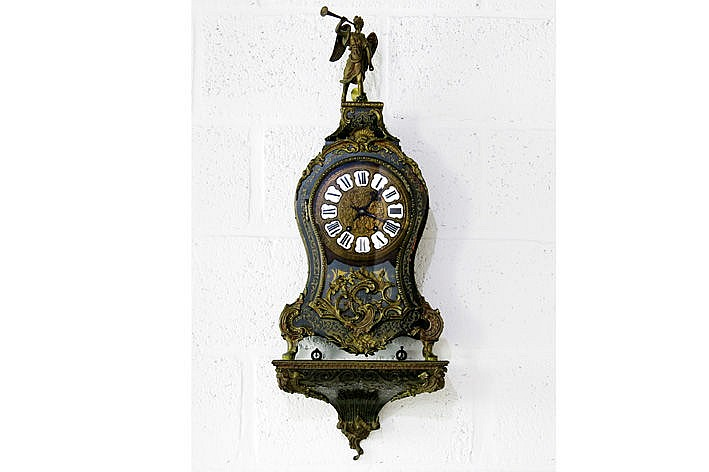 19th Cent. Napoleon III-clock with its console in 'Boulle' with mountings in bronze and with work with monogram