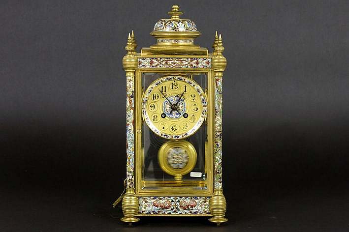 antique French clock with case in guilded bronze with cloisonn� and with a marked work and face