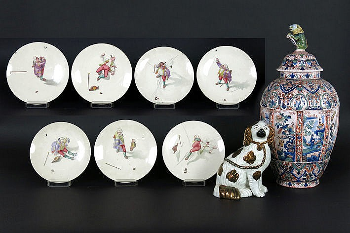 lot (9) : 7 plates in marked earthenware with polychrome representations with a fly a lidded vase in Delfts earthenware with polychrome decor and a Staffordshire dog