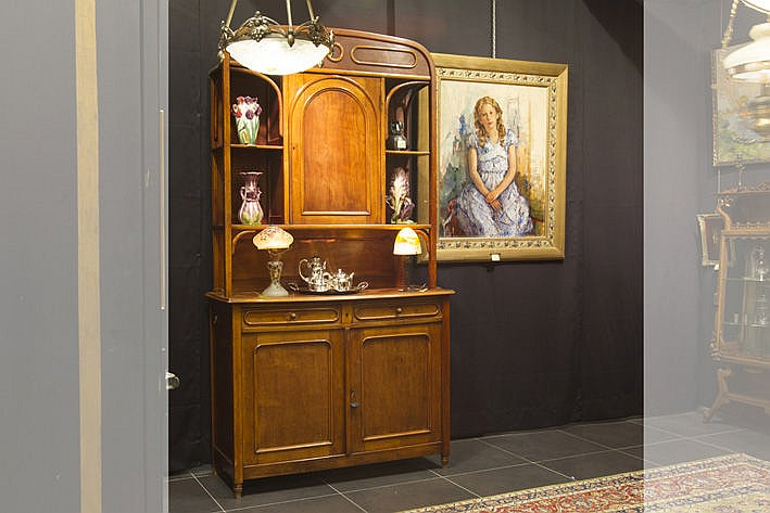 late 19th Cent. typical cupboard with at the bottom two doors and two drawers and on top a door flanked on either side by two open shelves - attributed to