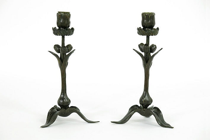 pair of (�) Art Nouveau-candlesticks in brown green patinated bronze with a coral shape and whiplash ornamentation