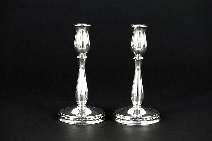 pair (�) of Art Deco-candlesticks in marked and signed silver