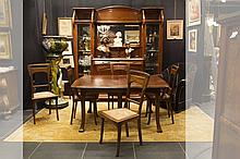 quite rare Art Nouveau whiplash style dining-room suite in walnut with finely carved whiplash ornamentationd cabinet are represented in