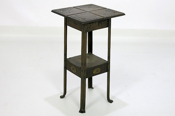 Jugendstil-occasional table in patinated metal and brass with typical ornamentation