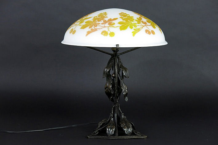 nice Art Deco-table lamp with wrought iron base with vegetal ears with berries and with a shade in p�te de verre with acid-etched vegetal decor