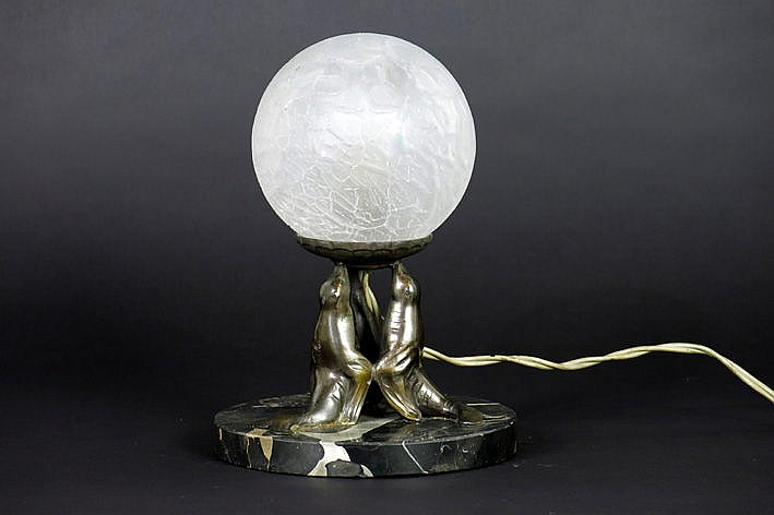 small Art Deco-lamp with a bulbous shade in satinised glass resting on three seals resting on a round marble base