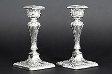 pair of antique candlesticks in marked and signed silver