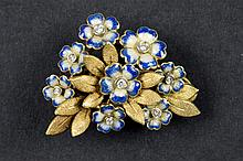 very caracteristic fifties' brooch in partially enamelled yellow gold (18 carat) and with brilliant cut diamonds