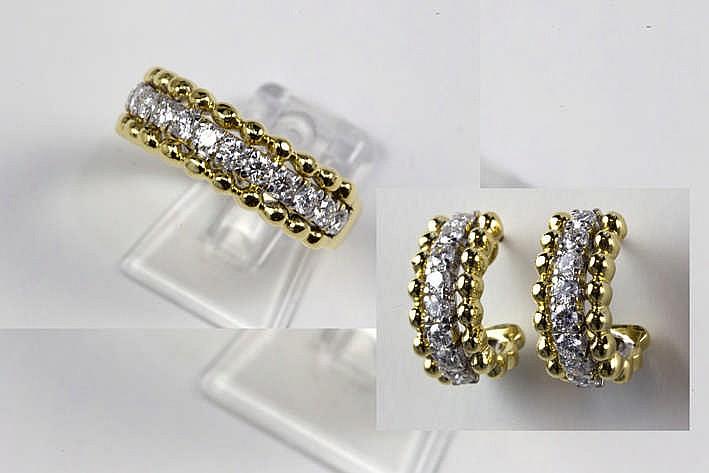 Fraaie juwelenset in geel en witgoud (18 karaat) bezet met ca 1 70 karaat witte (E/F/G) kwaliteitsbriljant (Vvs/Vs) en bestaande uit een paar oorbellen en een ring met zgn