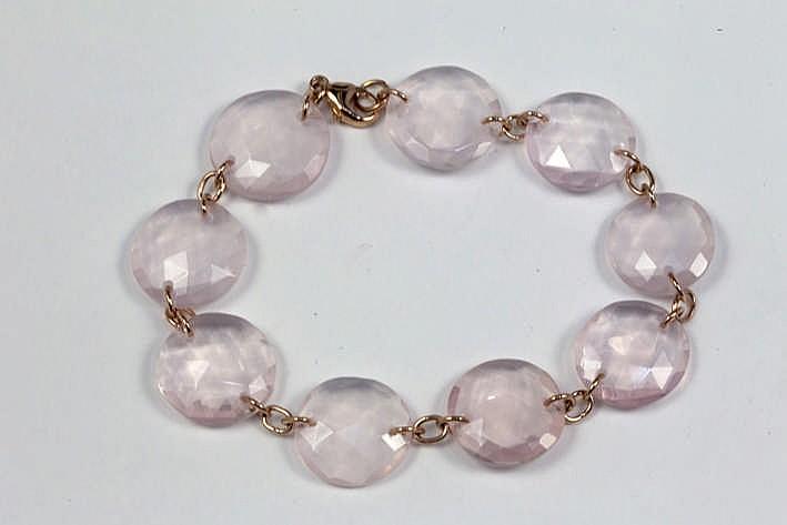 Modieus bracelet in roos goud (18 karaat) met rondom gefacetteerde ronde plaketten van rose quartz