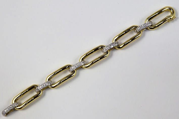 Fraai bracelet in witgoud (18 karaat) met een klassieke open gourmetteschakel en met ovale tussenstukjes bezet met briljant - in totaal : ca 2 karaat blauwwitte (E/F) kwaliteitsbriljant (Vvs/Vs) - 50 1 gram