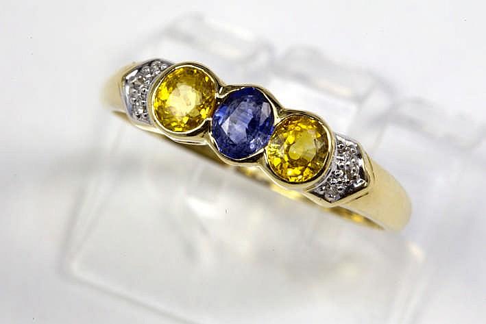 Mooie ring met bandmodel in geelgoud (18 karaat) met ca 1 karaat gele topaas en blauwe saffier en ca 0 30 karaat briljant