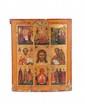 Icône Icône de la Sainte Face entourée, dans le registre supérieur de la transfiguration, du baptême, de St Nicolas, et dans le registre inférieur, de la vierge du signe et de différents saints. Epoque milieu XIXème siècle. Usures, manque en bas. 44