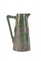 Cytère (Rambervillers)  Pichet de forme cylindrique en céramique  irisée à monture stylisée métallique. Signé.  H. : 25 cm.