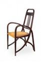 Thonet Paire de fauteuils en bois courbé et thermoformé teinté acajou. Les montants des dossiers sont ajourés et ornés de plusieurs barreaux cylindriques verticaux et viennent s'articuler sur le bas des pieds avant. Modèle n° 511 dans le goût des