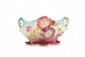 Delphin Massier (1836-1907) Jardinière de forme ovale en céramique polychrome à décor floral en semi relief en deux anses naturalistes appliquées. Signée. L. : 40 cm. Bibliographie : Modèles similaires répertoriés page 131 dans Massier, Éd. RMN 2000.