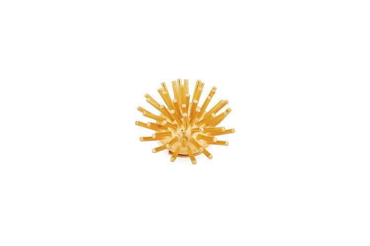 HERMES Paris  Broche clip sphérique ornée de picots en métal doré.