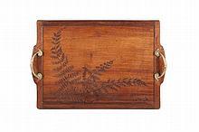 Louis Majorelle (1859-1926)   Plateau de service en acajou de forme rectangulaire à décor marqueté   de fougères. Poignets en bronze.   Signé.   H. : 54 cm. L. : 37 cm.