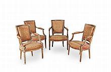 Suite de quatre fauteuils cabriolet en noyer mouluré à dossier rectangulaire et cintré avec accotoirs à manchette ; pieds fuselés et cannelés. Recouvrage de tapisserie au canevas à décor de ramages fleuris. Epoque Louis XVI. (renforts dans les