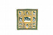 HERMES   Carré en soie imprimée vert et mastic, titré « Wedgwood »,    signé Ledoux.   Etat d'usage.