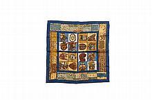 HERMES Paris   Gavroche en soie imprimée fond bleu, titré « Persona ».   Dessiné par Loïc Dubigeon.   42 x 42 cm.   Dans sa boîte.   Bon état.