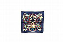 HERMES Paris   Carré en soie imprimée bleu marine, rouge et vert,   titré « Le mors A la Conétable ».   Etat d'usage.