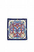 HERMES Paris   Carré en soie imprimée bleu, rouge et crème,    titré « Cavalcadour ».   Etat d'usage.