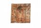 PLANCHE DE SARCOPHAGE  En bois peinte d'un Anubis, vêtu d'un pagne court et  d'une cuirasse, marchant à droite, flanqué de bandes  hiéroglyphiques au nom de Hotep. Polychromie d'origine.  Egypte. Basse Epoque.  22 x 22.5 cm.