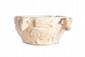 EXCEPTIONNEL VASE RITUEL AUX TAUREAUX Coupe hémisphérique à fond plat ornée de quatre bovidés passant en léger relief, les têtes proéminentes, en haut relief, dont une gravée d'un canal sur le dessus. Epis de blé sur le dos. Recollé. Marbre ou