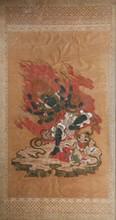 Peinture à l'encre et couleurs sur soie Sino-Tibétain, XIXème siècle. Représentant une divinité dansante, entourée de flammes, le corps bleu, à quatre visages et quatre paires de bras tenant ses attributs : cloche, gantha, glaive, vajra, corde, arc