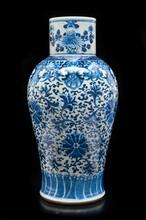 Paire de vases en porcelaine  bleu blanc  Chine, XIXème siècle.  De forme balustre, la panse et le col droit  à décor de lotus et rinceaux, pivoines et  fruits ; fêles aux deux vases. H. : 40 cm.  Deux couvercles rapportés non reproduits.