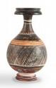 BOUTEILLE  En céramique peinte de motifs géométriques.  Gnathia. IVè s. av. J.-C.  H. : 16 cm.