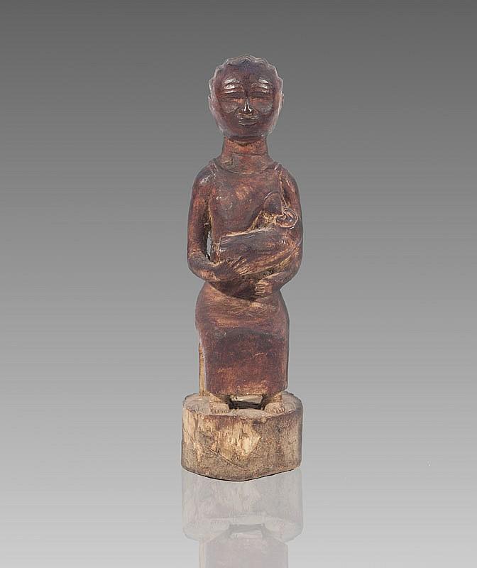 Maternité colon  BAOULÉ, Côte d'Ivoire.  Femme assise donnant le sein.  Bois à patine brun rouge.  H. : 29 cm.