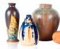 Ensemble de trois vases en céramique vernissée circa 1920. H. : 19 à 25 cm.