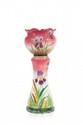 DELPHIN MASSIER (1836-1907) Cache-pot sur colonne en céramique polychrome à décor d'orchidées en léger relief. Signé sous le pied. H. : 94 cm.