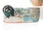 Charles GREBER (1853-1935) Cendrier en céramique vernissée à décor d'escargot. Signé. L. : 11 cm.