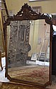 CARVED WOOD WALL MIRROR. Vertical format wall mirror with beveled panel glass border, top and sides with carved floral and drapery swag decoration. No mark. Size; 53''H, 36 1/2''W. Condition: age appropriate wear, surface covered with nicotine.