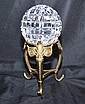 CRYSTAL PAPERWEIGHT WITH STAND. Large round crystal paperweight with intersecting line design, flat bottom. set on three footed brass stand. No mark. Size; paperweight: 5''H, 5''dia. widest part. paperweight on stand: 0 3/4''H. Condition: age