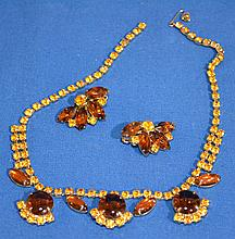AMBER RHINESTONE EARRINGS AND NECKLACE  Amber colored rhinestone jewelry. All jewelry sold as is.