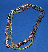 AFRICAN TRADE BEAD DOUBLE STRAND NECKLACE   African millefiore glass trade bead double strand necklace. One strand with striped beads. One strand with striped and green beads.  Each 22''L.  Condition all jewelry sold as is.