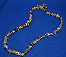 AFRICAN TRADE BEAD NECKLACE   African millefiore glass bead necklace.  35 beads total. Sizes range 1/4 - 1 1/2''L.  Necklace 22''L.  Condition all jewelry sold as is.