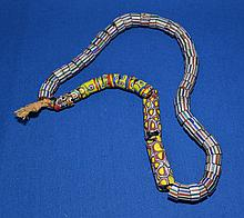 AFRICAN TRADE BEAD NECKLACE  African millefiore glass trade bead necklace with two styles of bead.  47 striped beads. 9 millefiore beads.  Necklace 22''L.  Condition all jewelry sold as is.