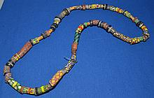 AFRICAN TRADE BEAD NECKLACE   African nillefiore glass trade bead necklace.  60 beads total. Sizes 1/4 - 1 1/2''L.  Necklace 28''L.  Condition all jewelry sold as is.