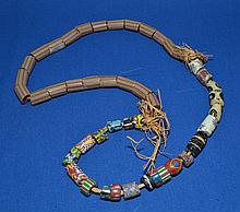 AFRICAN TRADE BEAD NECKLACE  African millefiore glass trade bead necklace. 45 beads. Sizes 1/4 - 3/4''L. Necklace 27''L.  Condition all jewelry sold as is.