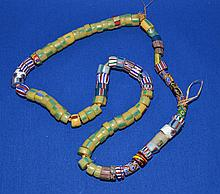 AFRICAN TRADE BEAD NECKLACE  African millefiore glass trade bead necklace.  Various sizes and designs. 70 beads.  Necklace 28''L.  Condition all jewelry sold as is.